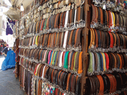Italy Tours leather belts in market